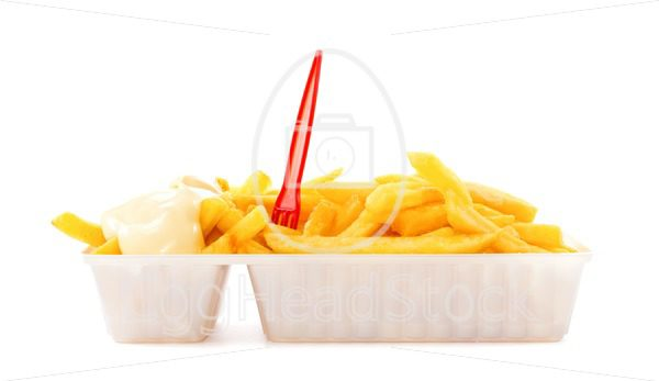 Portion of fries with mayonnaise and plastic fork - EggHeadStock