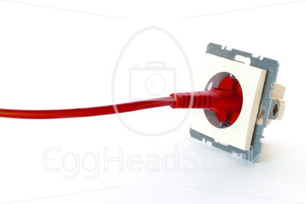 Red power cable plugged into wall outlet - EggHeadStock