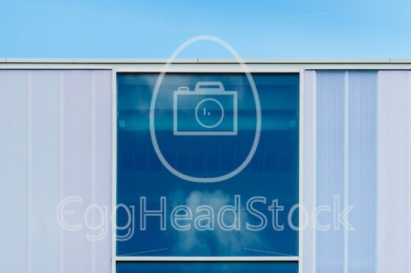 Reflection of clouds in blue window - EggHeadStock