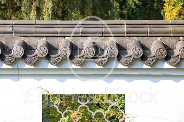 Roof tiles on white wall in in Chinese style - EggHeadStock