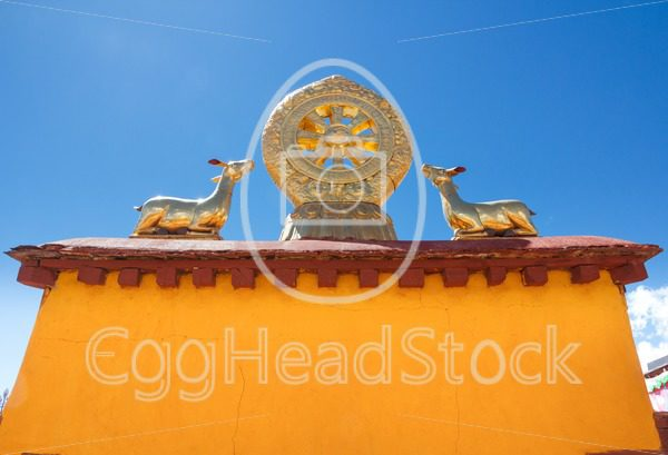 Rooftop statues of two golden deer flanking a Dharma wheel on the Jokhang Temple - EggHeadStock