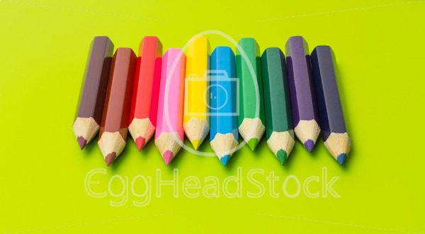 Set of colored pencils arranged in rainbow colors - EggHeadStock