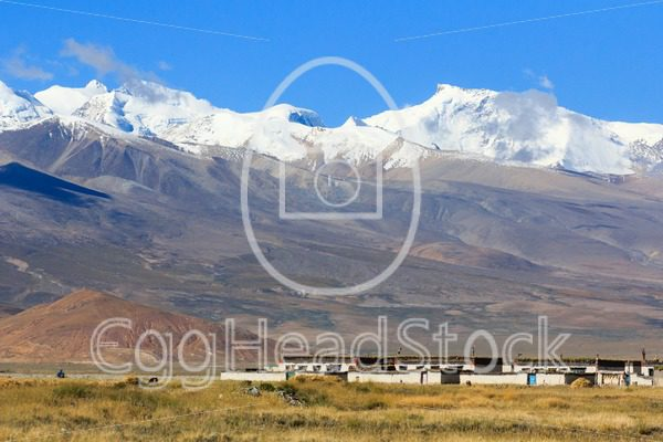 Settlement in Tibet with Himalayan range in the background - EggHeadStock