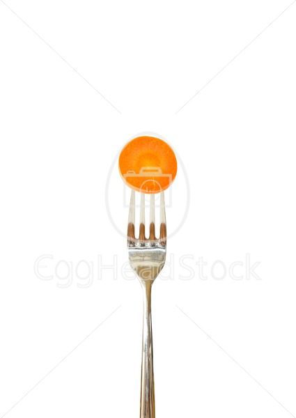 Slice of carrot pinned on a fork - EggHeadStock