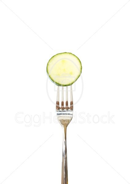 Slice of cucumber pinned on a fork - EggHeadStock
