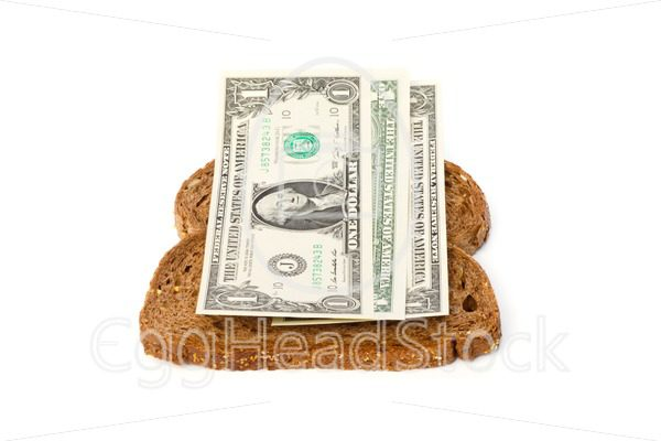 Slices of bread with dollar banknotes sandwich filling - EggHeadStock