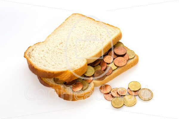 Slices of bread with euro coins spread - EggHeadStock