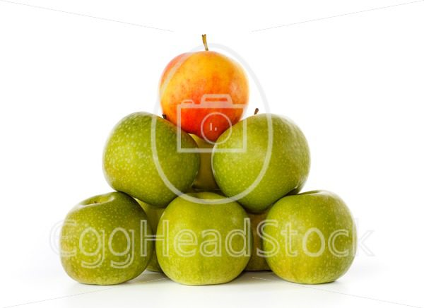 Stack of green apples and one yellow with red blush on top - EggHeadStock
