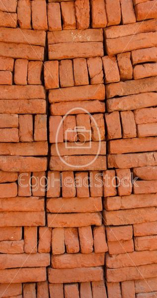 Supply of stacked orange bricks - EggHeadStock