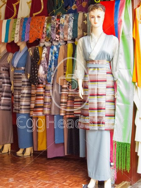 Tibetan traditional women costumes in a shop in Lhasa, Tibet - EggHeadStock
