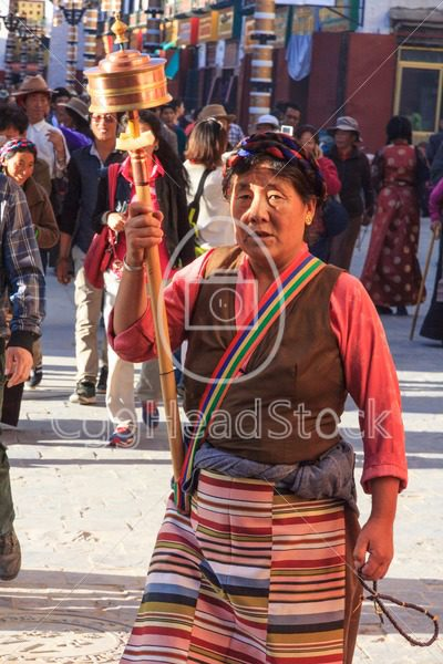 Tibetan women walking the pilgrimage route in Lhasa, Tibet. - EggHeadStock