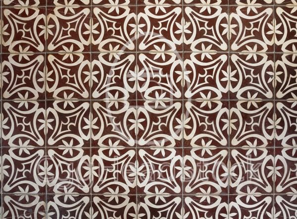 Tiled floor with brown Mediterranean decorations - EggHeadStock