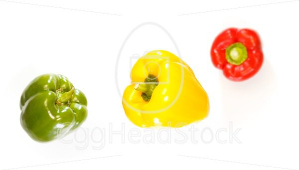 Top view of three peppers falling down - EggHeadStock