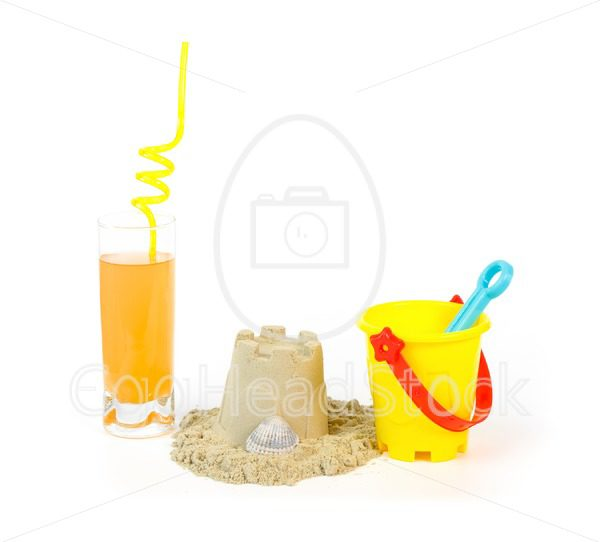 Toy bucket, sandcastle and a refreshing drink - EggHeadStock