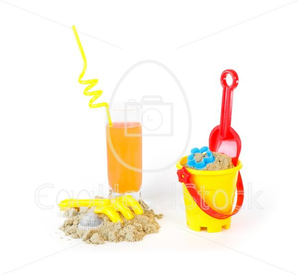 Toys for sand castles and a refreshing drink - EggHeadStock