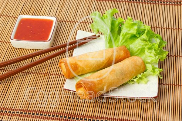 Two fried spring rolls on a plate - EggHeadStock