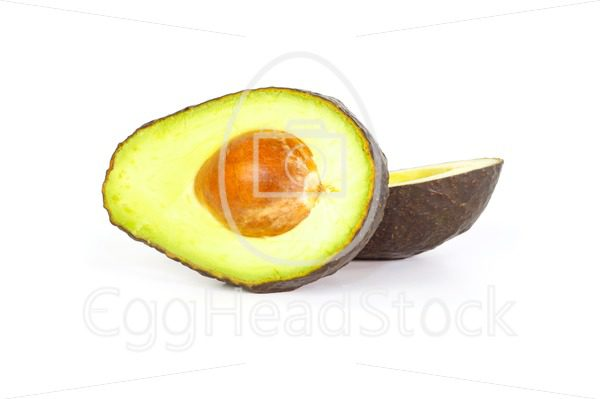 Two halves of avocados against white background - EggHeadStock