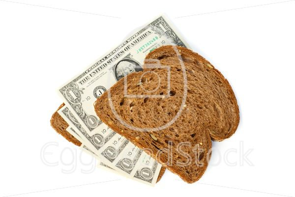 Two slices of bread topped with cash dollar bills - EggHeadStock
