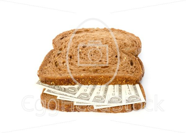 Two slices of bread with dollar banknotes sandwich filling - EggHeadStock