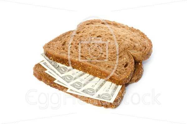 Two slices of bread with dollar banknotes sandwich spread - EggHeadStock