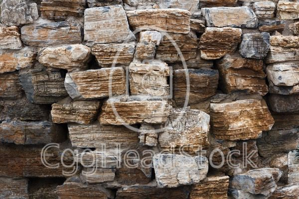 Wall built of rough natural stone - EggHeadStock