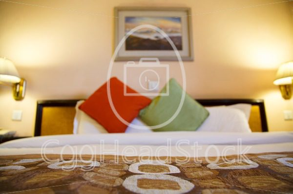 Warmly lit hotel room with shallow depth of field - EggHeadStock