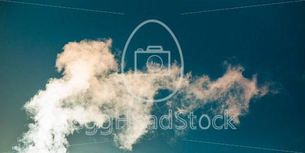 Water vapor against a blue sky - EggHeadStock
