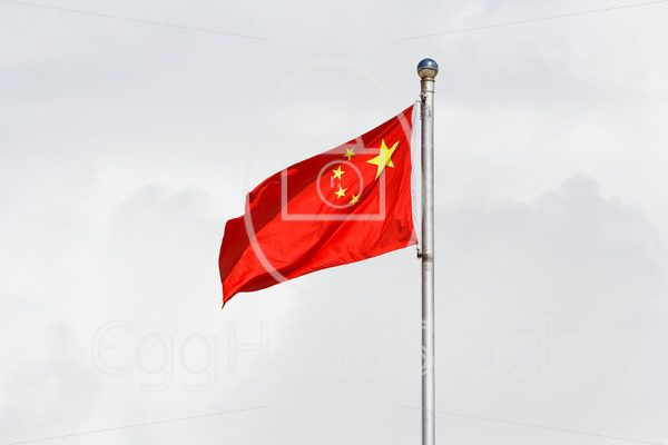 Waving Chinese flag against cloudy background - EggHeadStock