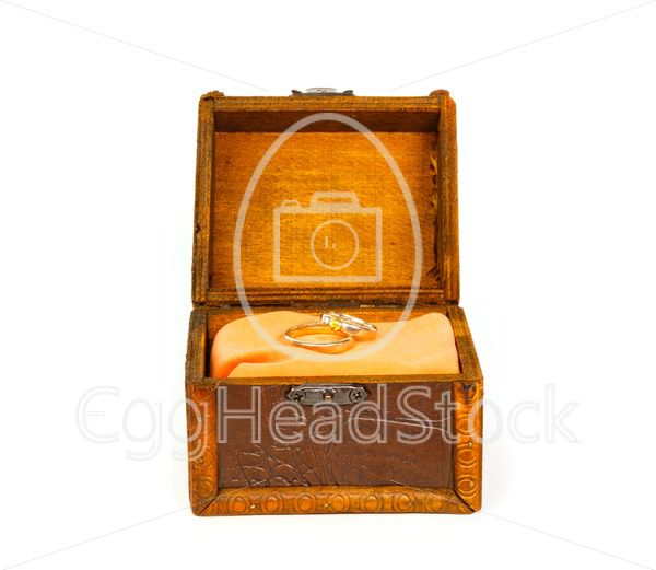 Wedding rings in open treasure box - EggHeadStock