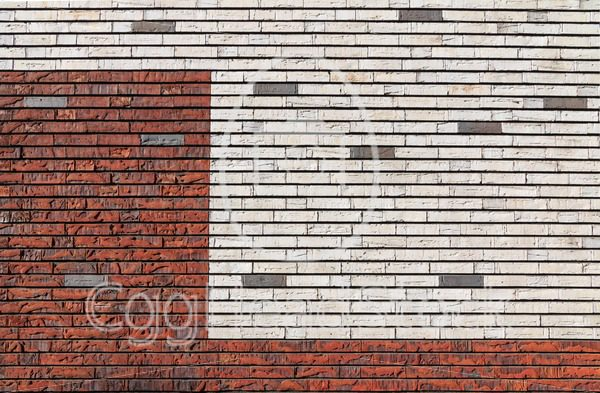 White and orange red brick wall interspersed with some gray bricks - EggHeadStock