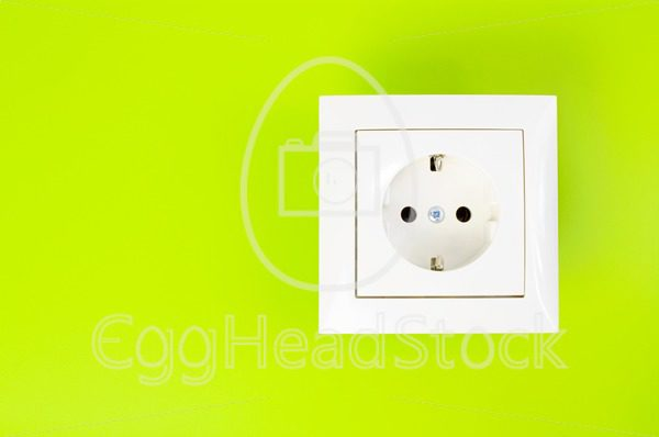 White power socket on green background - EggHeadStock
