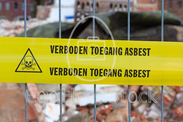 Yellow tape on fence with Dutch text 'no entry asbestos' - EggHeadStock