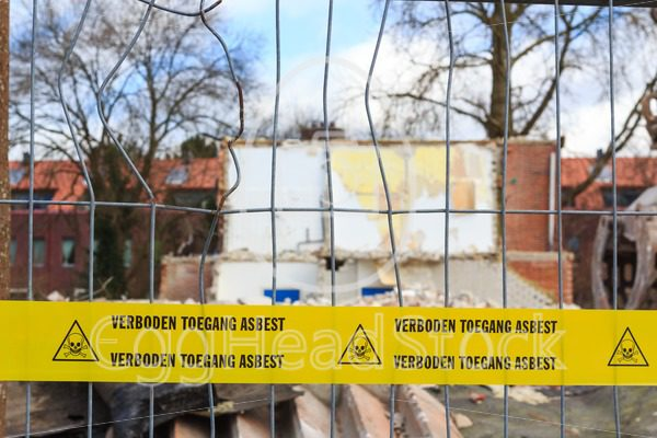 Yellow tape with Dutch text 'no trespassing asbestos' - EggHeadStock