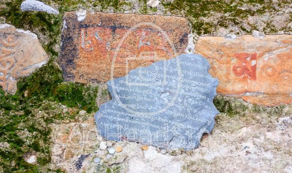Carved mani stone tablet with offered money - EggHeadStock