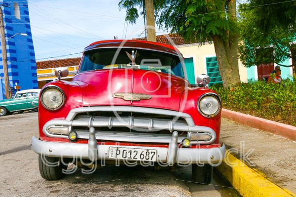 Old American Chevrolet Car parked in Sancti Spiritus, Cuba - EggHeadStock