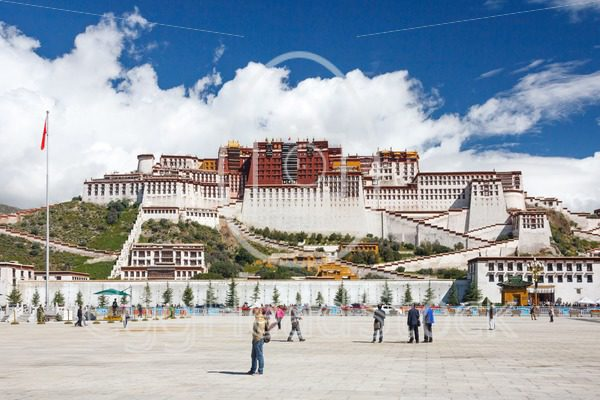 The Tibetan Potala Palace in Lhasa with tourists - EggHeadStock
