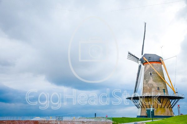 Traditional windmill on the dike in the Netherlands - EggHeadStock