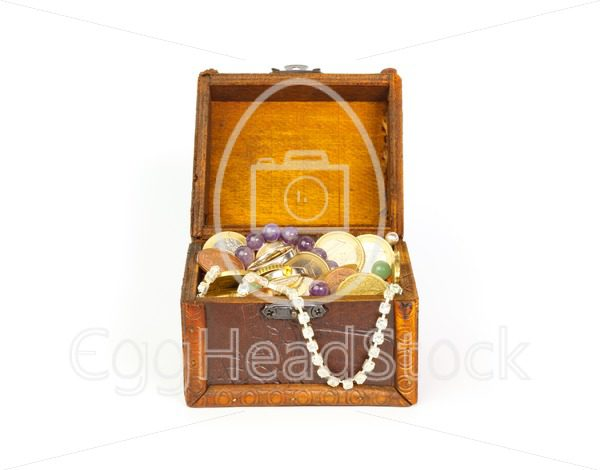 Open treasure chest with jewelry and money - EggHeadStock