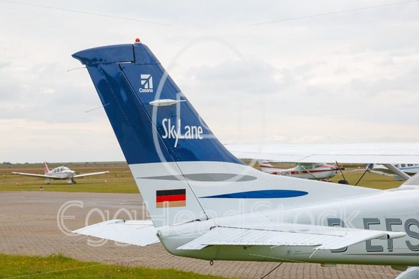 Cessna 182 Skylane parked at the airport - EggHeadStock