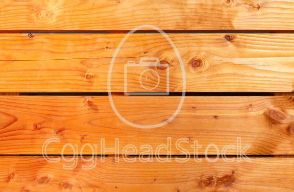 Background of orange oiled wooden planks - EggHeadStock