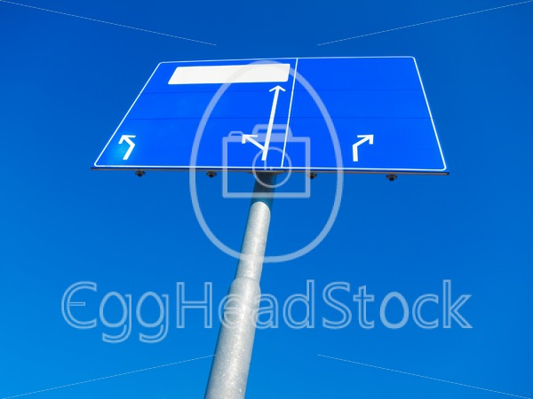 Blank direction sign pointing in different directions