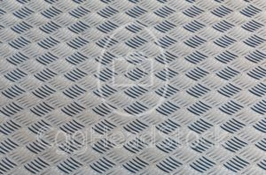Steel diamond plate background with shallow depth of field - EggHeadStock