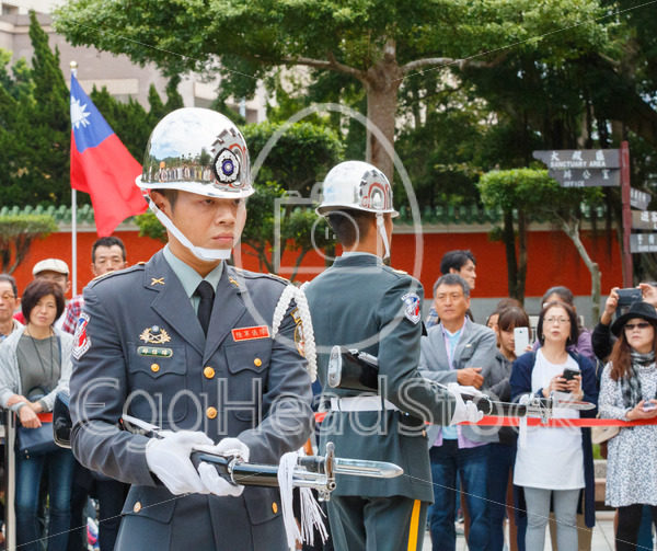 Ceremonial guards at National Revolutionary Martyrs' Shrine with tourist in the background - EggHeadStock