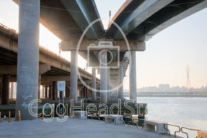 Urban view under the Sun Yat-sen Freeway 1 over the Tamsui River - EggHeadStock