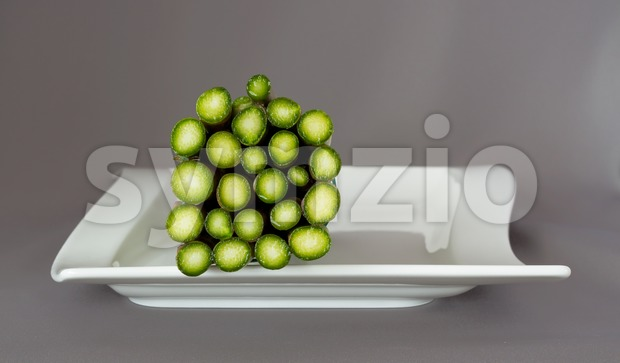 Bottom of a bundle of asparagus on a plate Stock Photo