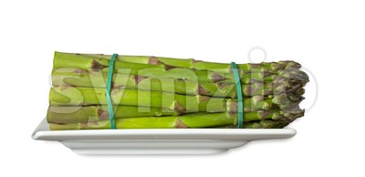 Green asparagus on a plate Stock Photo