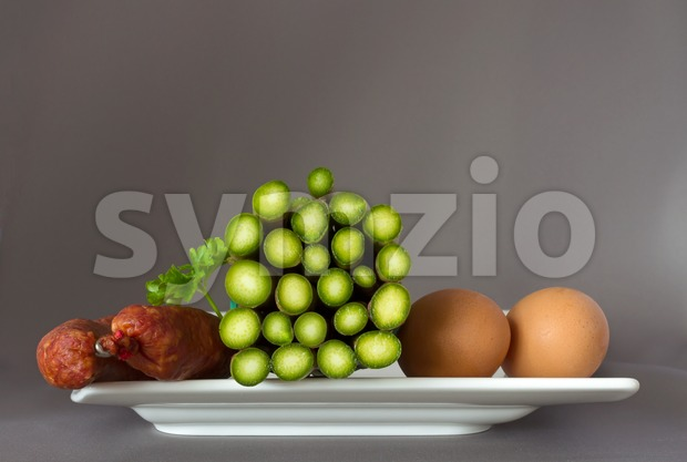 Asparagus, sausage and eggs on a plate Stock Photo