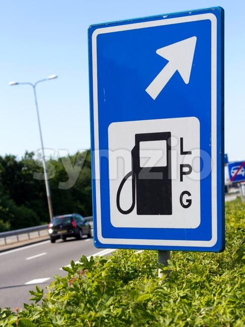 Filling station sign along a highway Stock Photo