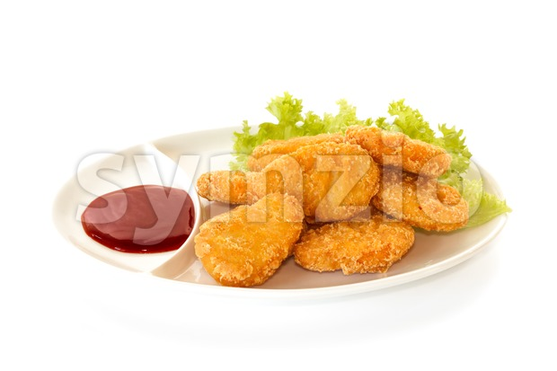 Plate of chicken nuggets with dip sauce, isolated on white background
