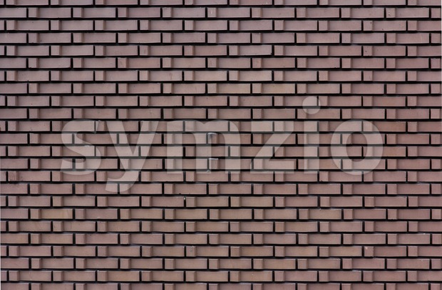 Stone wall with L-shaped brick Stock Photo